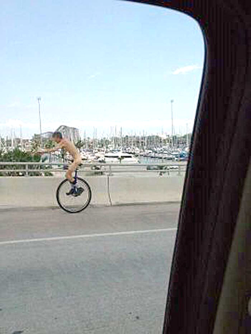 naked unicyclist