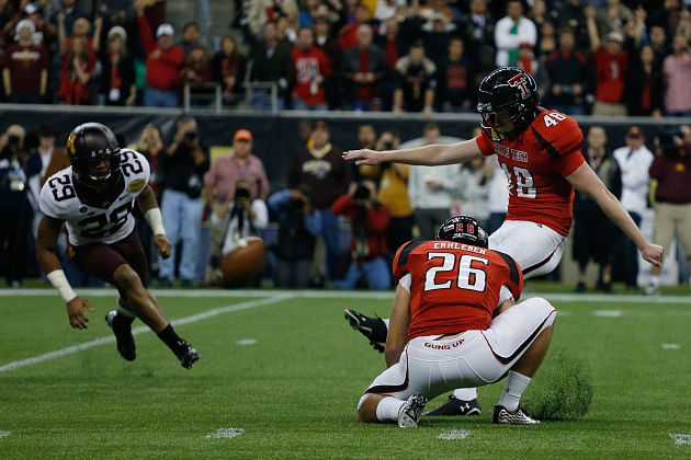 Texas Tech's Ryan Bustin kicks the game-winning field goal vs. Minnesota.