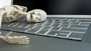 skeleton at keyboard