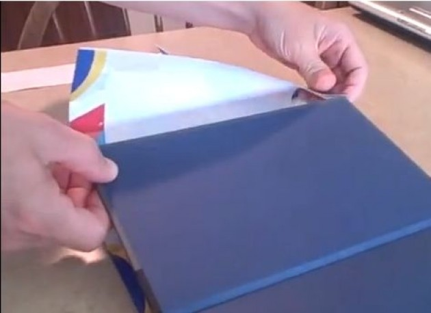covering a school book with a gift bag