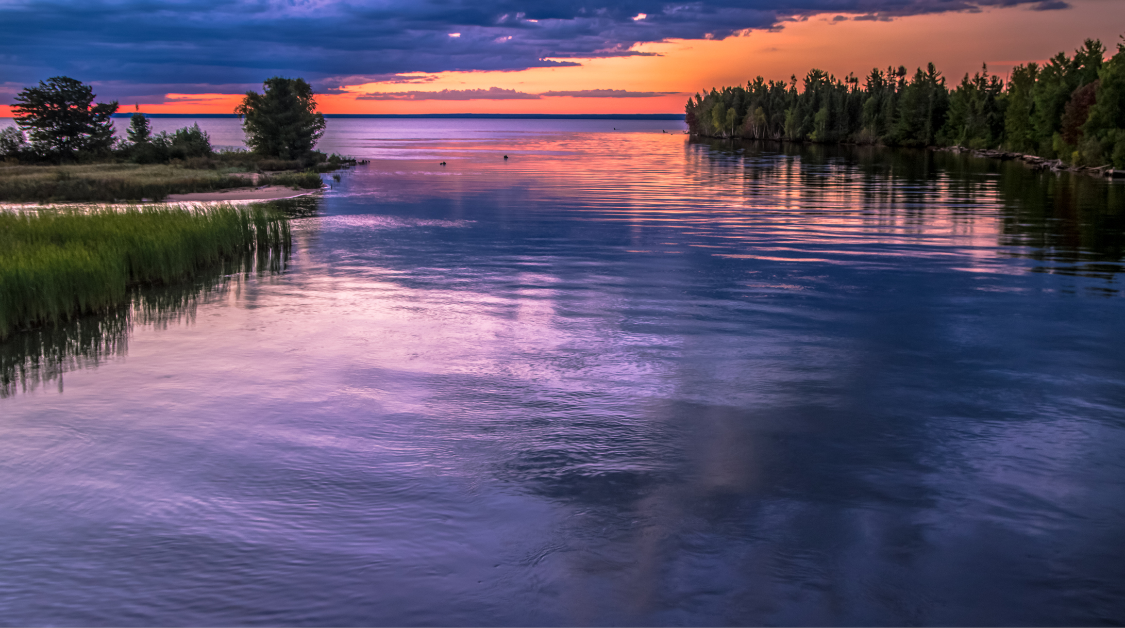 Sunrise Over The Tahquamenon River And Lake Superior
