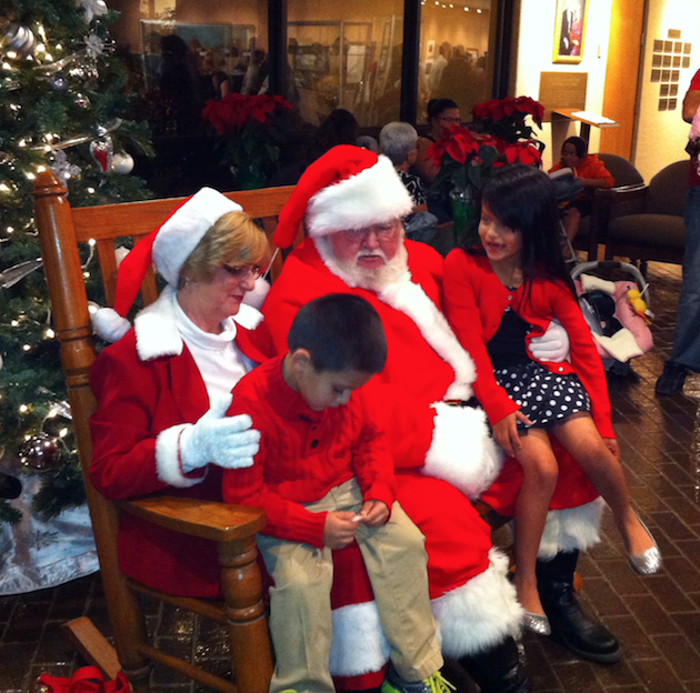 Santa and Mrs. Claus listen to wish lists