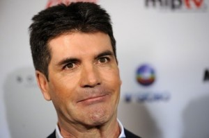Simon Cowell is in talks to team-up with Paula Abdul??