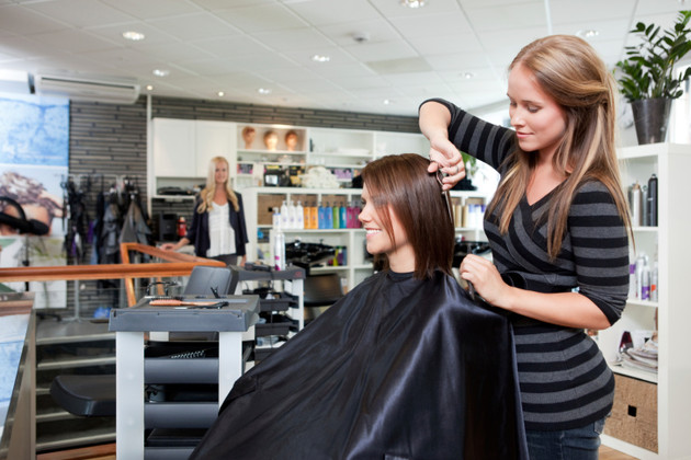 Hairdresser Thinning Customer's Hair
