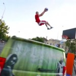 Amateur stuntman jumping a van and dunking a basketball