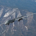 Unmanned MQ-1 Predator flying over Mountains | Erik Simonsen - Getty Images