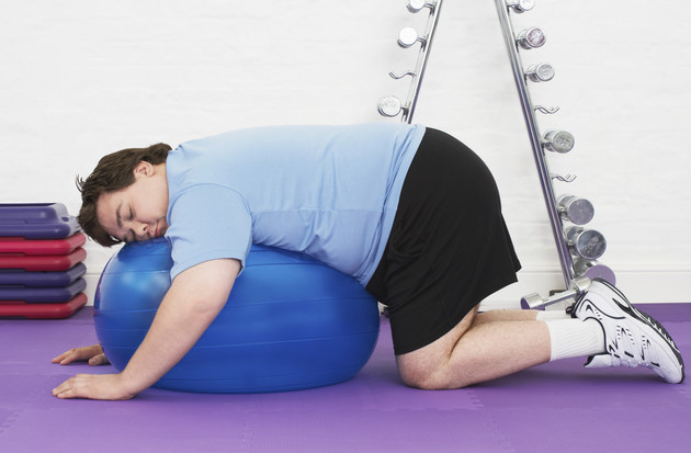 Overweight Man sleeping On Exercise Ball