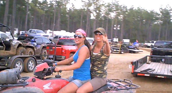 girls riding atv mudstock