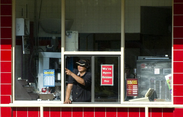 A woman working the drive-thru window at