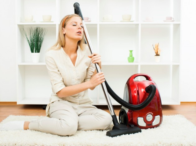 Woman with vacuum cleaner 630x472